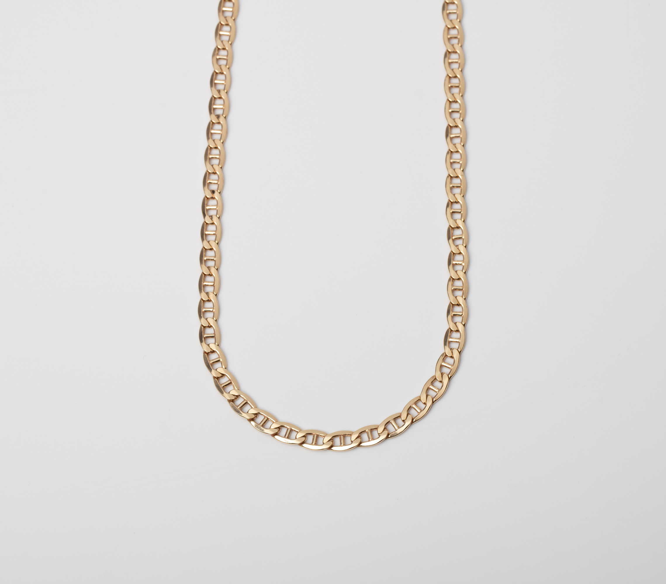 A 9CT GOLD AND SILVER BONDED MARINER CHAIN