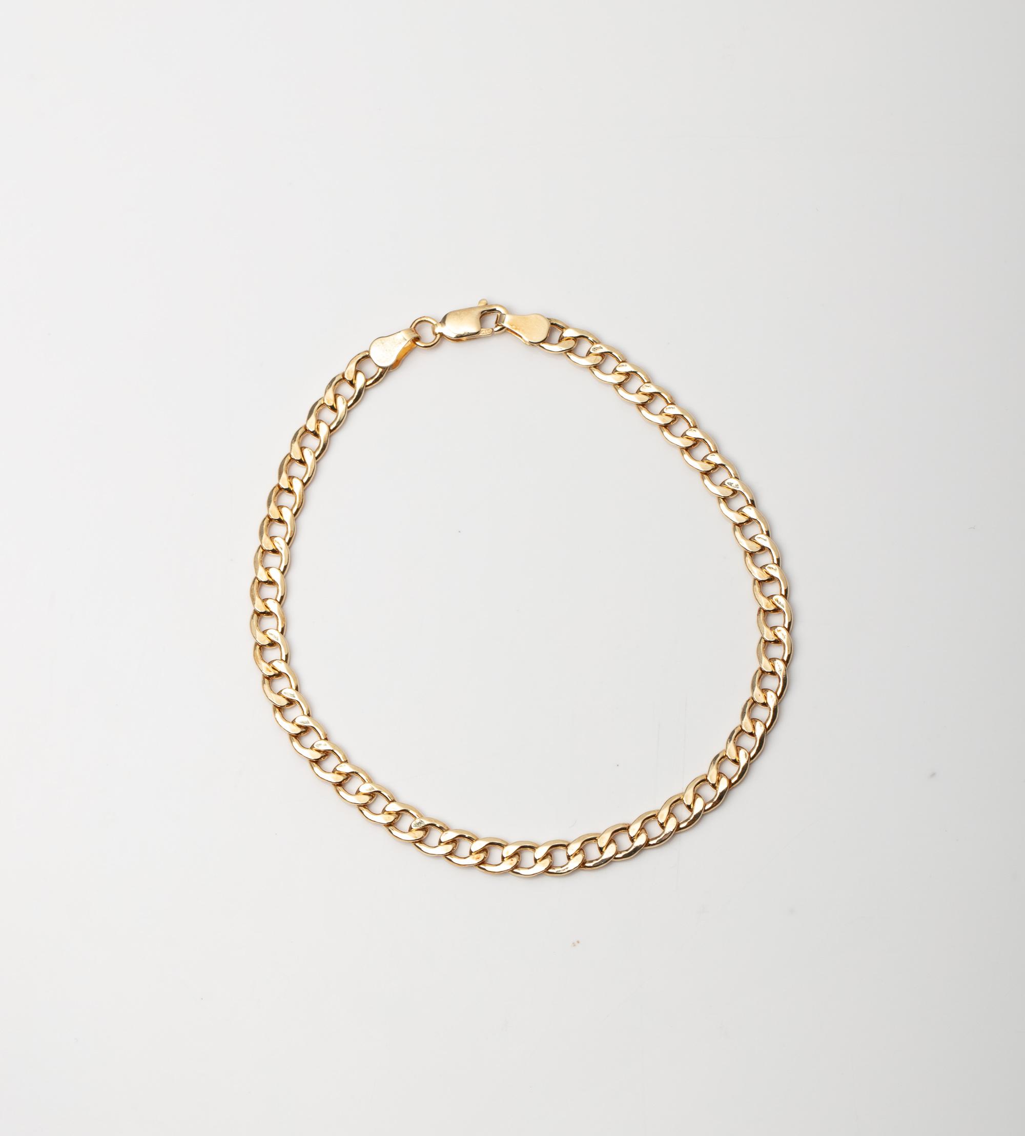 A 9CT GOLD & SILVER BONDED CURB BRACELET