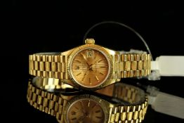 LADIES 18K ROLEX DATEJUST MODEL 69278, CIRCA 1988,SN 984....,round, champagne dial and gold hands,