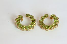 Pair of Peridot and Diamond set hoop earrings, set with a total of 22 peridots totalling
