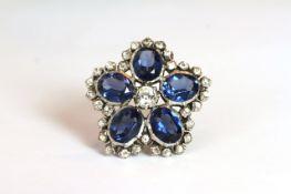 Antique paste set ring, five large blue oval cut paste stones set around a central round cut white