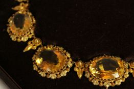 Georgian Citrine necklet, set with 11 oval shaped citrines with the largest measuring