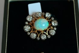Victorian Opal and Diamond set brooch, set with 1 oval shaped opal, 8 claw set, surrounded by 16