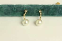 Pair of Pearl and Diamond drop earrings, set with 2 South Sea pearls