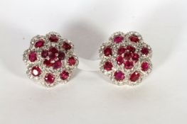 Burmese Ruby and Diamond Earrings, a fantastic pair of of tiered cluster earrings, 14 exceptional