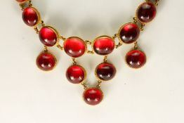 Victorian 15ct Cabochon Amber Necklace, graduating cabochon cut stones, foil backed, tested as