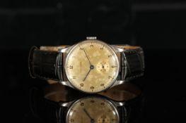 GENTLEMENS LONGINES CALATRAVA WRISTWATCH CIRCA 1946 REF. 23424, circular patina dial with black