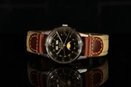 GENTLEMANS ZODIAC, round, black dial with illuminated hands, gold baton markers, day-date at 12 o