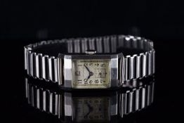GENTLEMENS LONGINES WRISTWATCH, rectangular patina dial with black Arabic numerals and gun metal