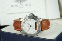 GENTLEMENS BREITLING NEW PLUTON WRISTWATCH W/ BOX & PAPERS REF. A51037, circular silver dial with