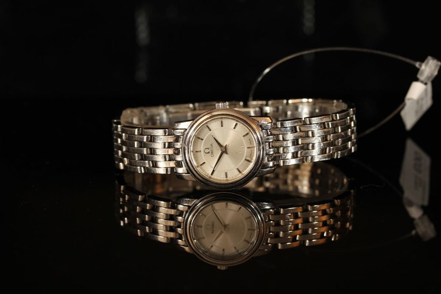 Lot 51 - LADIES OMEGA DRESS WATCH NO 57803218, round silver dial with silver sword hands, silver baton