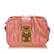 Miu Miu Gathered Leather Shoulder Bag, this shoulder bag features a gathered leather body, flat