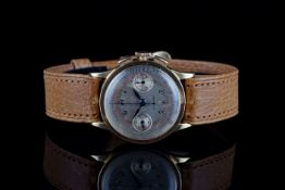 GENTLEMENS UNIVERSAL CHRONOGRAPH 18CT GOLD WRISTWATCH, circular patina twin register dial with black