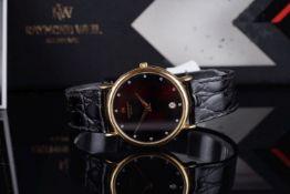 GENTLEMENS RAYMOND WEIL DATE WRISTWATCH W/ BOX & BOOKLET, circular black dial with diamond dot