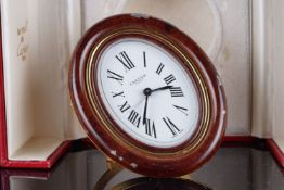 VINTAGE CARTIER DESK CLOCK W/ BOX, oval white dial with black roman numerals, black hands and