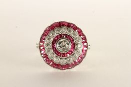 Ruby and Diamond Ring, centre set with an old cut diamond, surrounded by a halo of calibre cut
