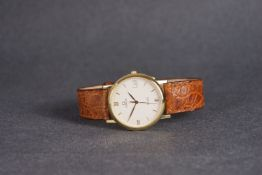 GENTLEMENS OMEGA DE VILLE DATE 18CT GOLD WRISTWATCH, circular silver dial with gold hour markers and