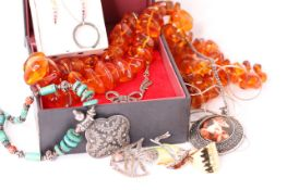 Mixed ot of costume jewellery including silver and vintage pieces and amber