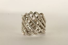 Diamond Swirl Ring, set with round brilliant cut diamonds, stamped 18ct white gold, finger size K
