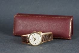 GENTLEMENS GARRARD 9CT GOLD WRISTWATCH W/ BOX, circular silver dial with arabic numerals and gold