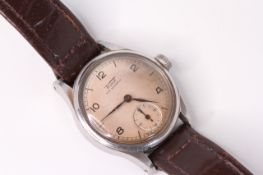 Vintage Tissot, circular dial Arabic numerals, subsidiary seconds, screw down case back, brown