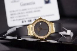 LADIES HUBLOT DATE 18CT GOLD DIAMOND SET WRISTWATCH, circular black dial with gold hands and a