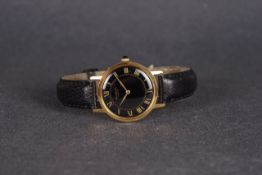 GENTLEMENS RAYMOND WEIL WRISTWATCH, circular black dial with gold roman numeral hour markers and