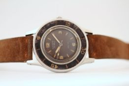 VERY RARE VINTAGE BLANCPAIN AQUA-LUNG CIRCA 1950S, circular black patina dial, baton and Arabic
