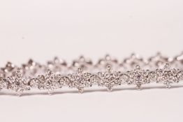 Daisy-Style Diamond Line Bracelet, approximate total diamond weight 5.20ct