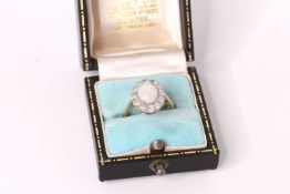 Vintage Opal and Diamond cluster ring, 9x7mm cabochon Opal, a cluster of brilliant cut diamonds,