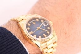 GENTLEMEN'S ROLEX OYSTER PERPETUAL DAY DATE REFERENCE 18038 CIRCA 1984, Blue sunburst diamond set