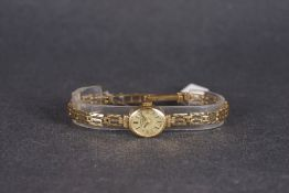 LADIES ROTARY 9CT GOLD WRISTWATCH, oval gold dial with gold hour markers and hands, 14mm 9ct gold