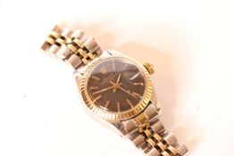 LADIES TWO TONE ROLEX DATE WRISWATCH, circular black dial with gold hands and gold hour markers,