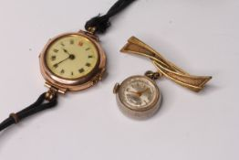 Vintage 9ct ladies watch, white dial, Roman numerals, red 12, cord strap, together with a gold