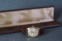 GENTLEMENS TALIS DATE WRISTWATCH W/ BOX, circular silver dial with gold baton hour markers and