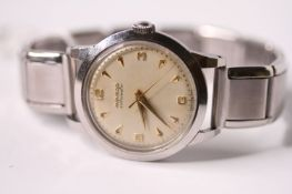 VINTAGE 1940S MOVADO BUMPER AUTOMATIC, circular cream dial, gilt dagger and Arabic hour markers