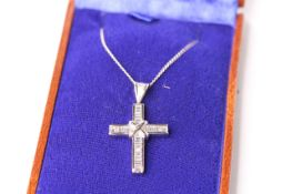 Diamond Cross Necklace, set with baguette cut diamonds totalling approximately 1.00ct, pendant is