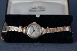 LADIES 9CT GOLD COCKTAIL WATCH W/ BOX, circular two tone dial with arabic numeral hour markers and