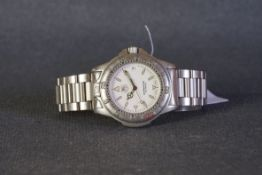 GENTLEMENS TAG HEUER PROFESSIONAL DATE WRISTWATCH, circular white dial with luminous hour markers