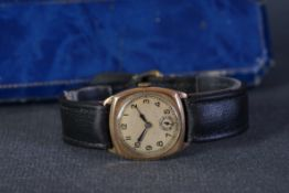 GENTLEMENS 9CT GOLD WRISTWATCH W/BOX, circular patina dial with arabic numeral hour markers and