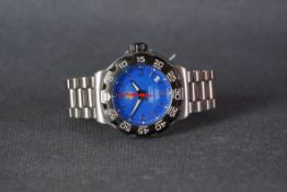 GENTLEMENS TAG HEUER FORMULA 1 DATE WRISTWATCH, circular blue dial with silver hour markers and