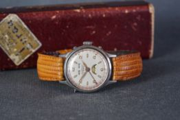 GENTLEMENS DUVOISIN & CIE TRIPLE CALENDAR MOONPHASE WRISTWATCH W/ BOX, circular off white dial