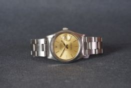 GENTLEMENS ROLEX OYSTER PERPETUAL DATE WRISTWATCH, circular champagne dial with baton hour markers