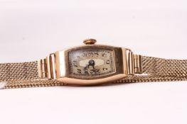 Art Deco 9ct Cocktail watch, rectangular cushion dial with Arabic numerals, 14mm tonneau shaped