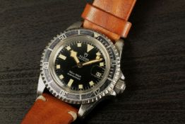 GENTLEMENS RARE TUDOR SUBMARINER 'SNOWFLAKE' WRISTWATCH REF. 9411, circular black meters first dial,