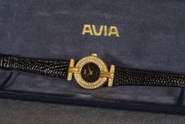 ***TO BE SOLD WITHOUT RESERVE*** LADIES AVIA QUARTZ WRISTWATCH W/ BOX, circular black dial with gold