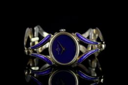LADIES BAUME & MERCIER ENAMEL WRISTWATCH, oval lapis lazuli dial, stone set crown, 25mm 18ct