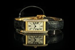 LADIES 18K DIAMOND SET CARTIER AMERICAINE , MODEL 1710,oblong dial, beige face with blue hands,