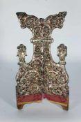 Díptico en plata repujada con decoración de ángeles y flores. México, siglo XVIII.Díptico
