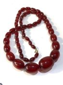 Antique cherry amber / bakelite bead necklace largest bead measures approx 3.1cm by 2.3cm weight 90g